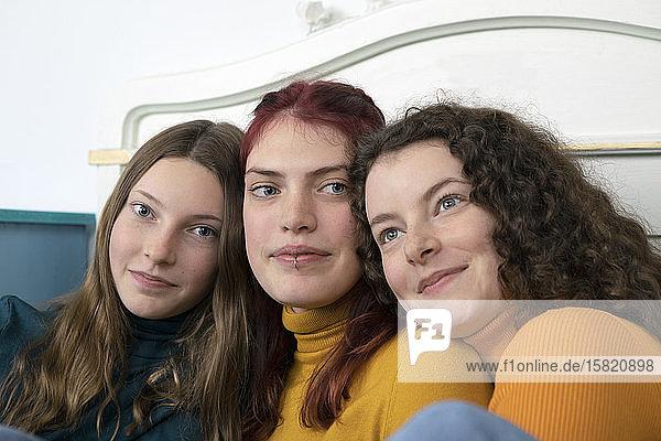 Portrait of three happy sisters