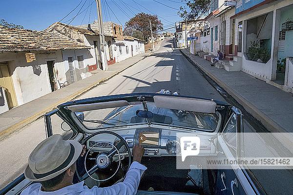 Taxi driver driving a vintage convertible car  Trinidad  Cuba