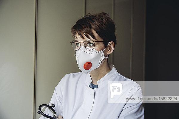 Female doctor wearing FFP3 mask