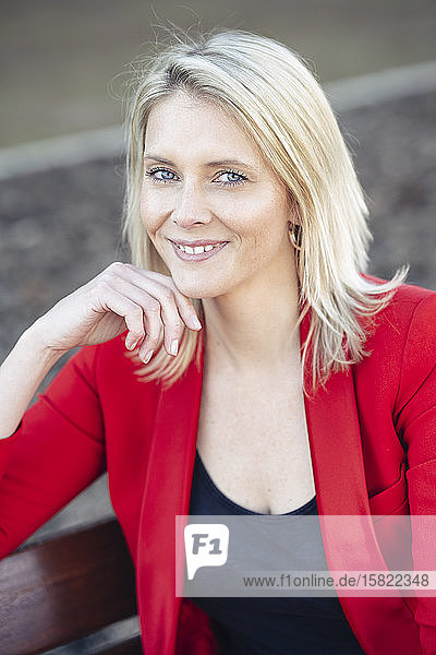 Blond businesswoman wearing red suit