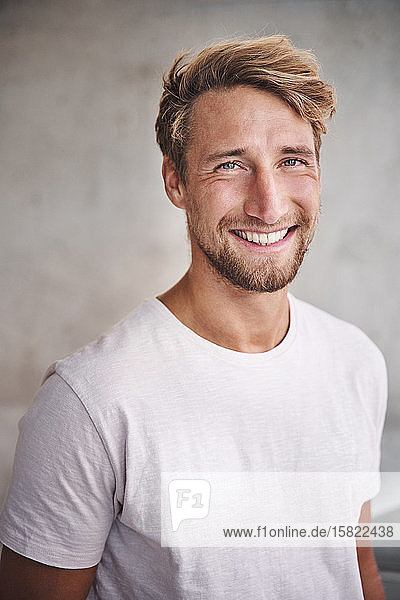 Portrait of happy young man wearing white t-shirt