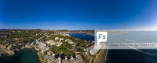 Spain  Balearic Islands  Costa de la Calma  Aerial panorama of clear blue sky over coastal town in summer