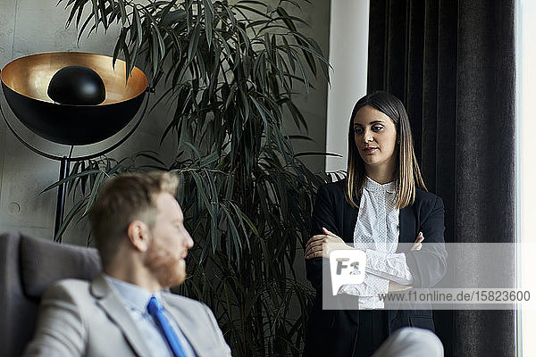 Businessman and businesswoman in hotel lobby