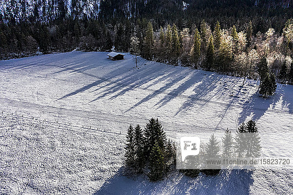 Germany  Bavaria  Reit im Winkl  Helicopter view of snow-covered landscape in Chiemgau Alps