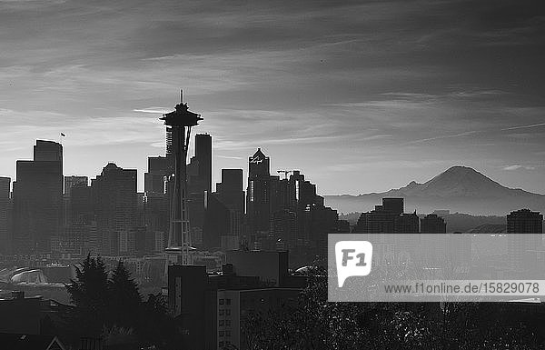 Downtown Seattle Sunrise with the Space needle  and Mount Rainier.
