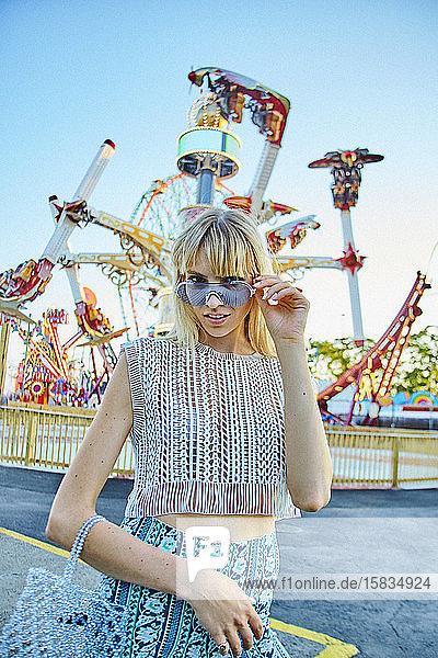 Blonde beauty at amusement park