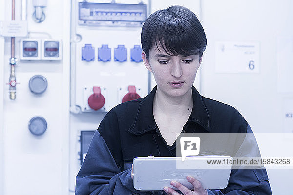 engineer woman with a device checking and controlling
