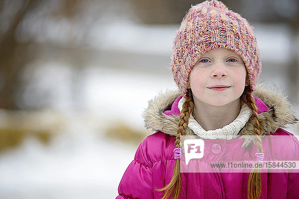Little Girl With Red Hair Outdoors in Winter