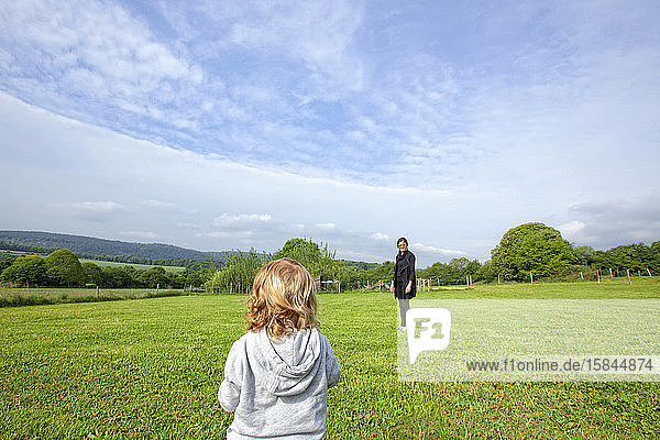 a little boy and his mom having fun on a green field in the country side  Caurel Brittany  France.