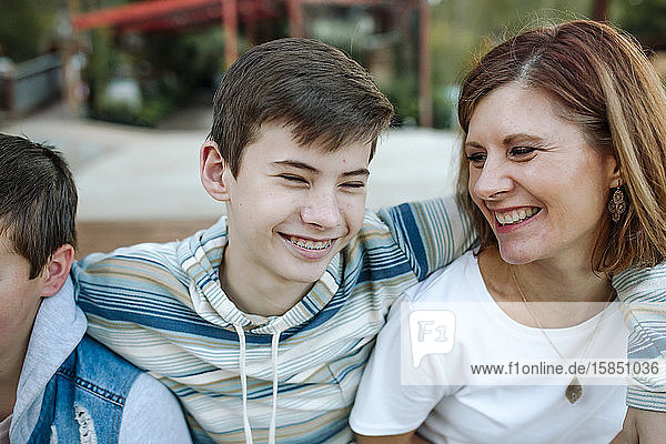 Laughing mom and teen son sharing a happy moment