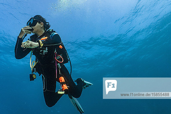 female diver performing a safety stop in 5meters depth in Australia