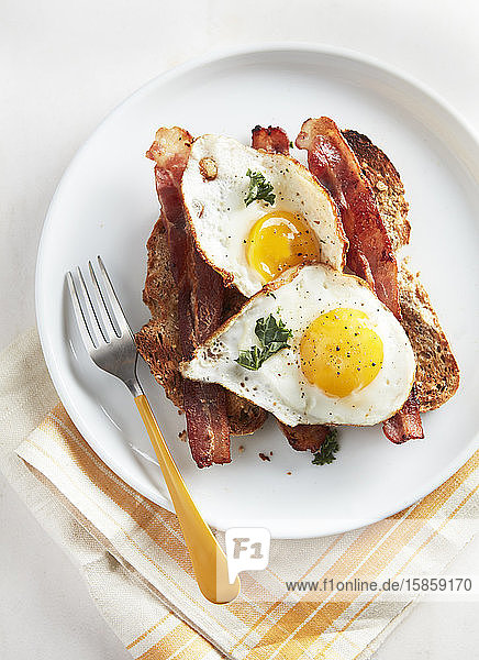 Two Eggs Sunny Side Up Bacon and Toast