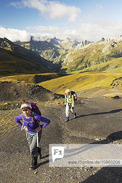 Walkers on the Tour de Mont Blanc ascending the Col de la Seigne