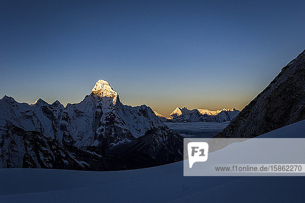 Alpine sunset over the mountains with Ama Dablam in the Himalaya