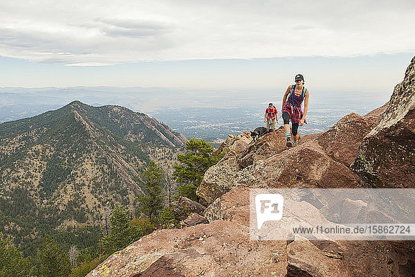 Hikers and dog hike to summit of Bear Peak above Boulder  Colorado