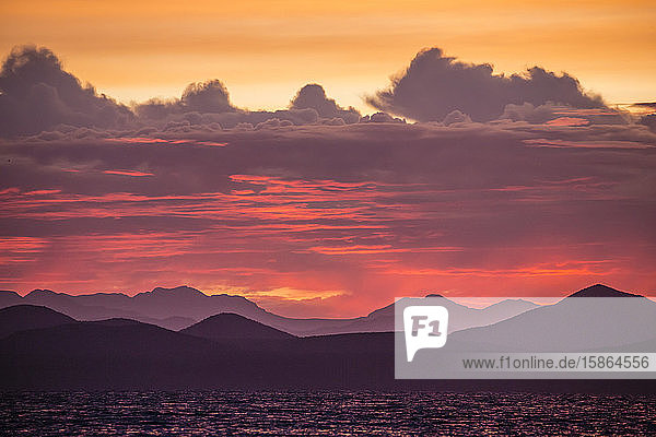 Intense clouds and sunset over Baja Peninsula from Isla Ildefonso  Baja California Sur  Mexico  North America