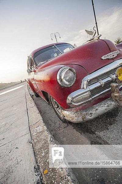 Red car on the Malacon  Havana  Cuba  West Indies  Caribbean  Central America