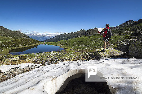 Hiker at Lakes Porcile  Tartano Valley  Orobie Alps  Lombardy  Italy  Europe