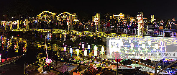 Bridge at nighttime with illuminated lanterns on boats; Hoi An  Quang Nam Province  Vietnam