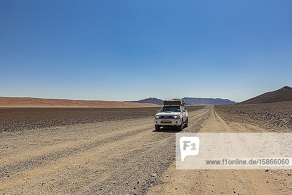 Driving on a long  dry road  Namib Desert; Namibia