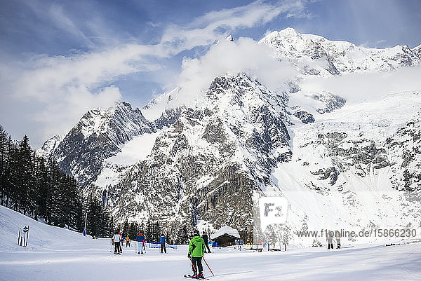Skiers at an alpine resort  Italian side of Mont Blanc; Courmayeur  Aosta Valley  Italy