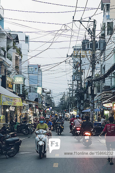 Busy street with motorcycles and pedstrians; Ho Chi Minh City  Vietnam