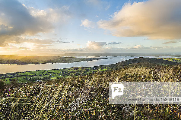 Landscape view of Irish hill and countryside with a lake in the distance; Tauntinna  County Tipperary  Ireland