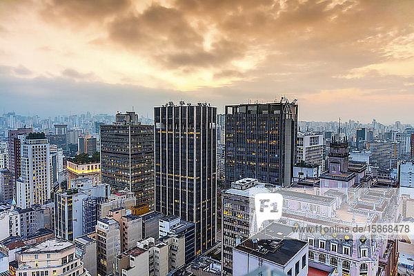 Skyscrapers under glowing orange clouds at sunset; Sao Paulo  Sao Paulo  Brazil