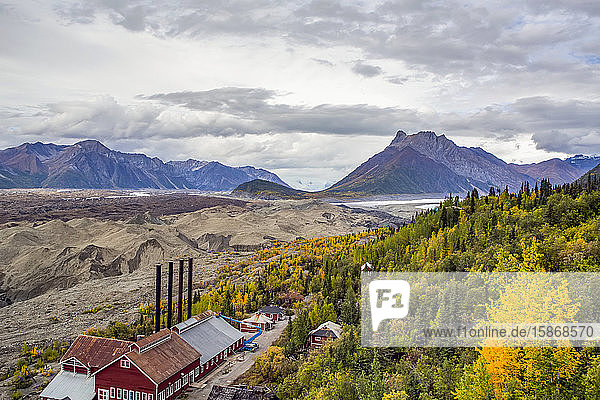 Looking down below from the top of the Kennecott Concentration Mill  one can see the Kennicott Glacier and the power plant that is being renovated; Alaska  United States of America