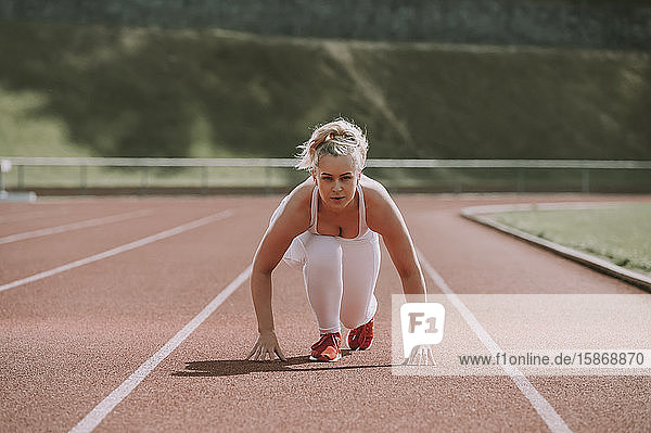 Woman in a starting position for running on a track; Wellington  New Zealand