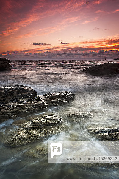 Sunset over the rocks along the French Atlantic shoreline; Perharidi  Brest  France