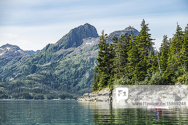 Kayaker paddling in Prince William Sound; Alaska  United States of America