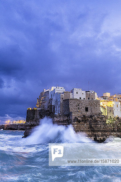 Waves crash on the cliff during a winter storm at dusk  Polignano a Mare  Apulia  Italy  Europe