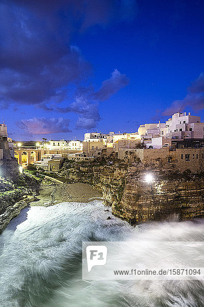 Waves crash on the beach during a winter storm  Polignano a Mare  Apulia  Italy  Europe