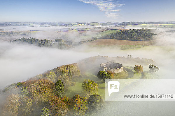 Aerial view by drone of Restormel Castle on a misty autumn morning  Lostwithiel  Cornwall  England  United Kingdom  Europe