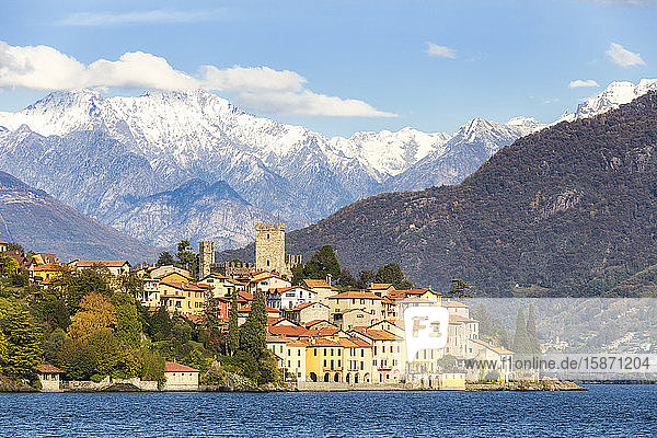 Village of Rezzonico with snowcapped mountains in the background  Lake Como  Lombardy  Italian Lakes  Italy  Europe