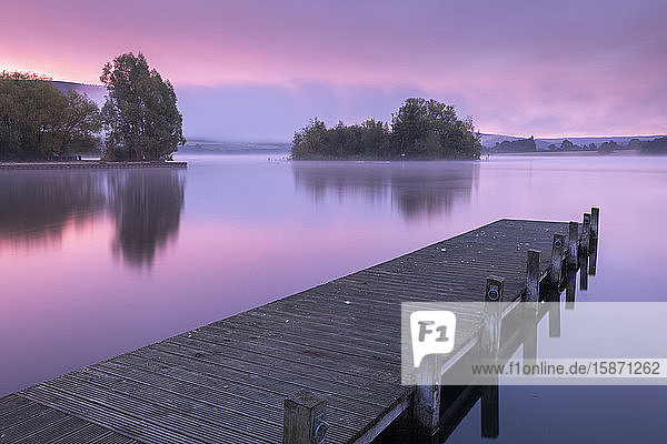 Pink sunrise over Llangorse Lake in the Brecon Beacons National Park  Powys  Wales  United Kingdom  Europe