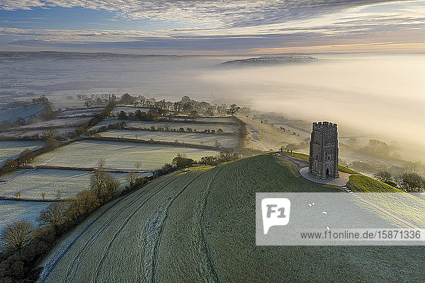 Aerial view by drone of frosty winter morning at Glastonbury Tor  Somerset  England  United Kingdom  Europe