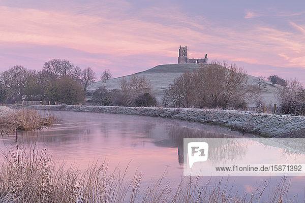 Church ruins on Burrow Mump at dawn on a frosty winter morning  Somerset  England  United Kingdom  Europe