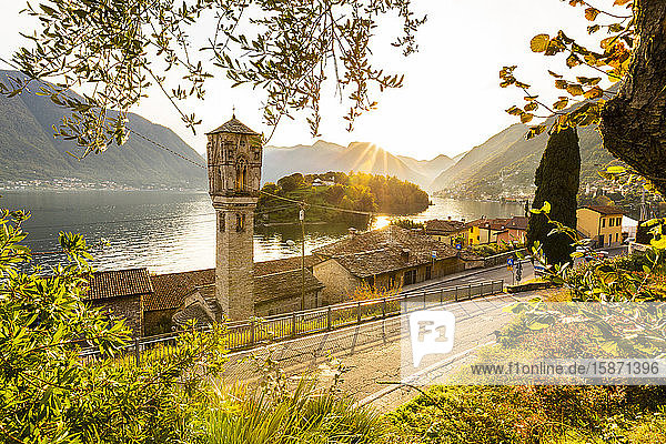 Traditional bell tower of Ossuccio with view of the Comacina Island and Lake Como  Lombardy  Italian Lakes  Italy  Europe