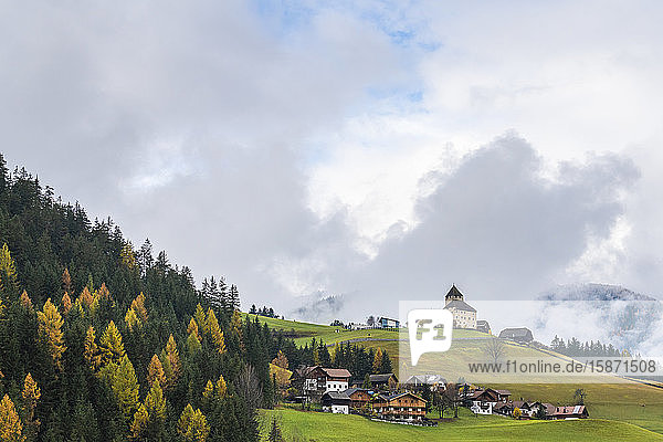 Ciastel de Tor surrounded by woods in autumn  San Martino in Badia  Val Badia  Dolomites  South Tyrol  Italy  Europe