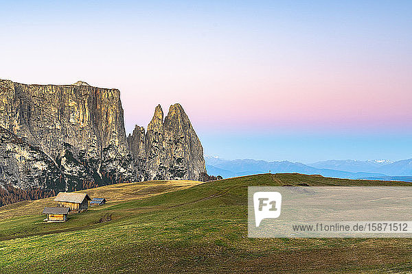 Autumn sunrise over Sciliar peaks and wood huts at Alpe di Siusi (Seiser Alm)  Dolomites  South Tyrol  Italy  Europe