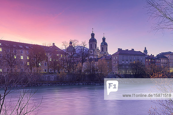 Cathedral of St. James is reflected in Inn River at sunrise  Innsbruck  Tyrol  Austria  Europe