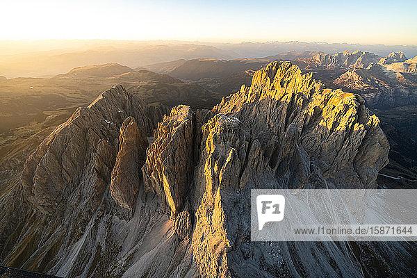 Aerial view of Sassolungo and Sassopiatto lit by the warm autumn sunset  Val Gardena  Val di Fassa  Dolomites  South Tyrol  Italy  Europe