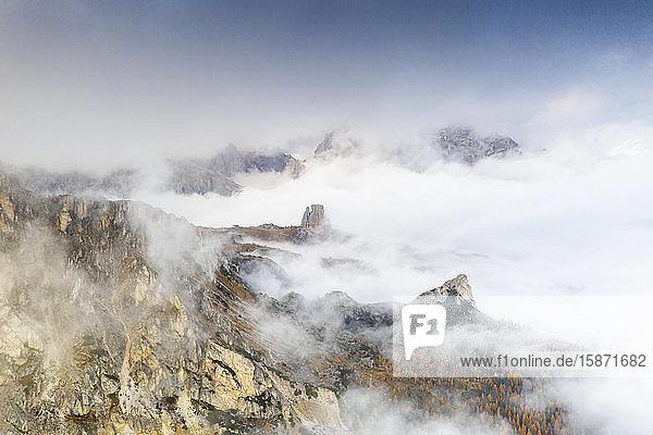 Aerial view of autumn mist over the trees and woods surrounding Cinque Torri and Tofane  Giau Pass  Dolomites  Belluno  Veneto  Italy  Europe