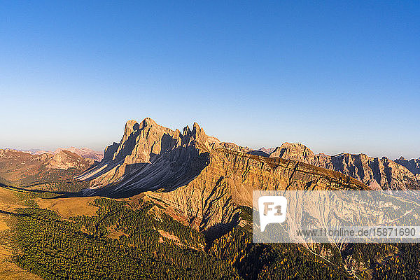 Aerial view of sunset over Seceda mountain in autumn  Cisles-Odle Nature Park  Dolomites  Val Gardena  South Tyrol  Italy  Europe