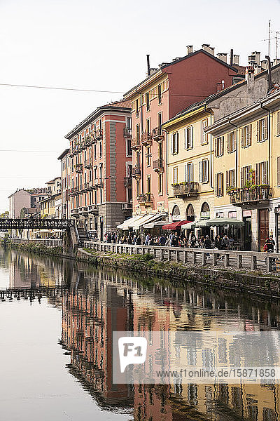 Old buildings reflected in the Naviglio Grande  Milan  Lombardy  Italy  Europe