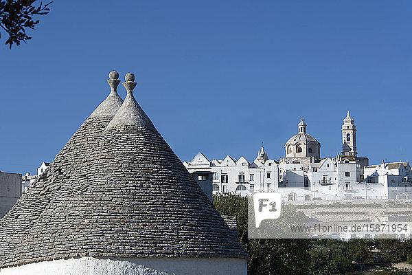 Cone shaped roofs of Trulli outside the historic center of Locorotondo  Valle d'Itria  Bari district  Puglia  Italy  Europe