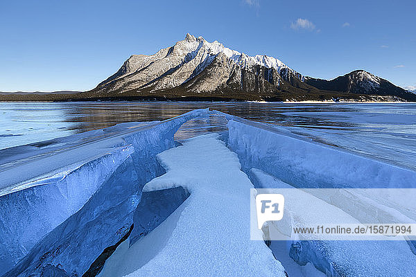 Ice formations with Mount Michener in the background at sunrise  Abraham Lake  Kootenay Plains  Alberta  Canadian Rockies  Canada  North America