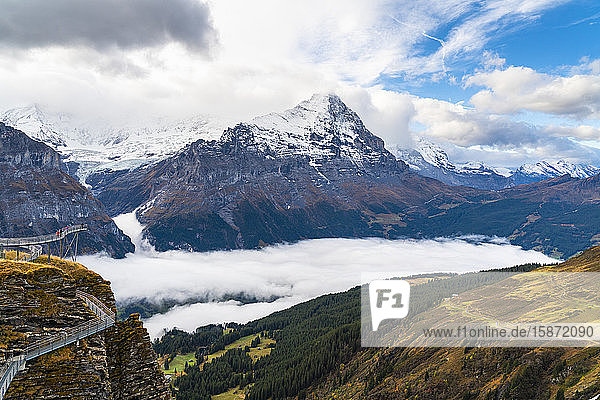 People admiring Mount Eiger from First Cliff Walk elevated walkway  Grindelwald  Bernese Oberland  Canton of Bern  Switzerland  Europe